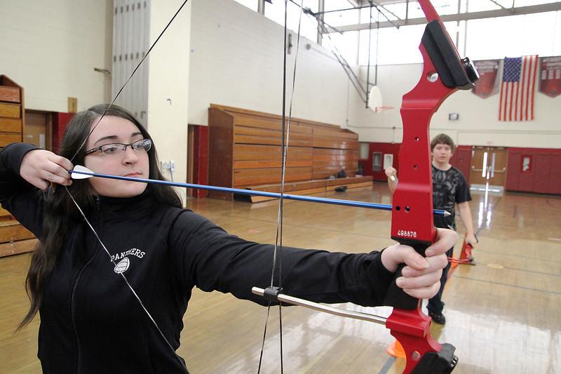 Ayer Shirley Regional High School sophomorecEmma Taylor, 15, gets ready to shoot an arrow during Physical Education teacher Jamie Lamoreaux's archery class on Wednesday afternoon. SENTINEL & ENTERPRISE/ JOHN LOVE