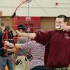Ayer Shirley Regional High School sophomore Tyler Landry, 15, gets ready to shoot an arrow during Physical Education teacher Jamie Lamoreaux archery class on Wednesday afternoon. SENTINEL & ENTERPRISE/ JOHN LOVE