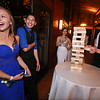 From left, Molly Cadogan and Ulises Resendiz of Ayer, Tiana D'Andrea of Lunenberg and Max Milkowski of Shirley, play Jenga at the Ayer-Shirley prom. (SUN/Julia Malakie)