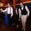 Max Simmons, left, and Alex Patano, both of Ayer, play cornhole at the Ayer-Shirley prom. (SUN/Julia Malakie)
