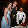 Angelina Cooper of Ayer, Mayden Shelton of Fitchburg, and Marcus Fields of Shirley, at Ayer-Shirley prom. (SUN/Julia Malakie)