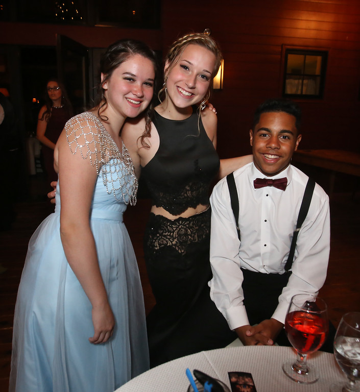. Angelina Cooper of Ayer, Mayden Shelton of Fitchburg, and Marcus Fields of Shirley, at Ayer-Shirley prom. (SUN/Julia Malakie)