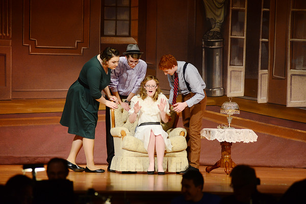 Leigh Calhoun played by sophomore Julia Jenkins, seated center is surrounded by clockwise from left Billie played by junior Amanda Cyrus, Marshall played by junior David Bender and Val played by sophomore Noah Pollio, pressuring her for funding for their performance.