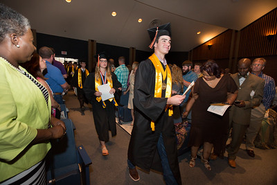 Valedictorian Cody Bradford leads the procession of seniors at Baccalaureate at Aledo High School.