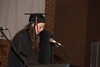 Kaitlin Detherage leads a prayer at Baccalaureate