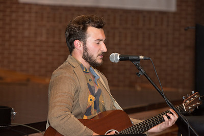 Caleb Grant, Worship Pastor at Christ Chapel Bible Church, leads singing during the service