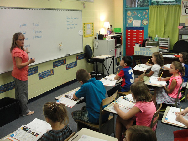 Students in Shannon Stefano's third grade class get focused on the first day on the new school year Thursday at John Milledge Academy.