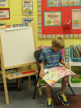 A John Milledge Academy second-grader in Mary Byrne's class takes advantage of reading time before lunch. Thursday marked the first day of school for JMA students.