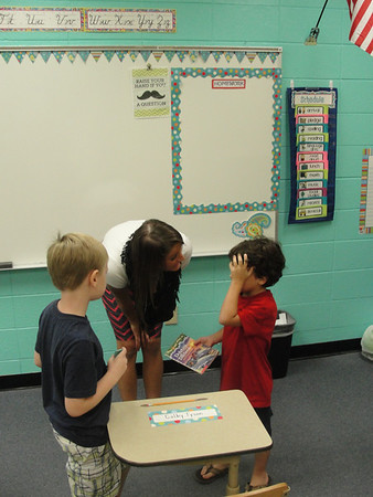 A second grade student speaks with Mary Byrne Thursday morning on the first day of school for John Milledge Academy.