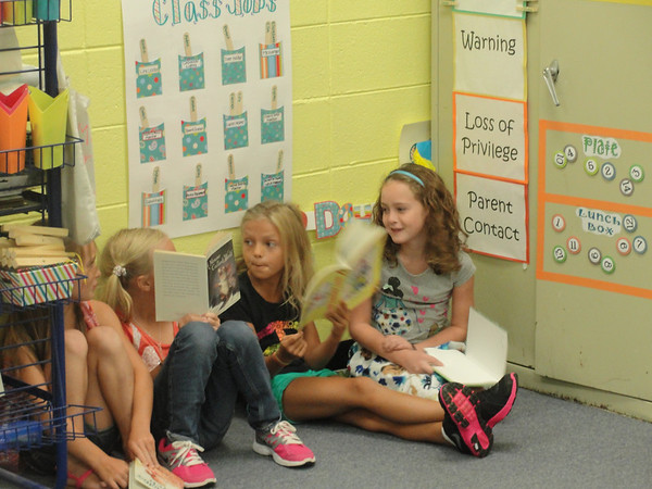 John Milledge Academy students in Mary Byrne's second grade class enjoy reading time Thursday.