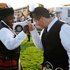 Don Knight |  The Herald Bulletin<br /> From left, Ariana Sanglton and Kodie Bair tap their trumpet mouthpieces together as the Anderson Marching Highlanders prepare for their performance during Band Day at the State Fair on Saturday.