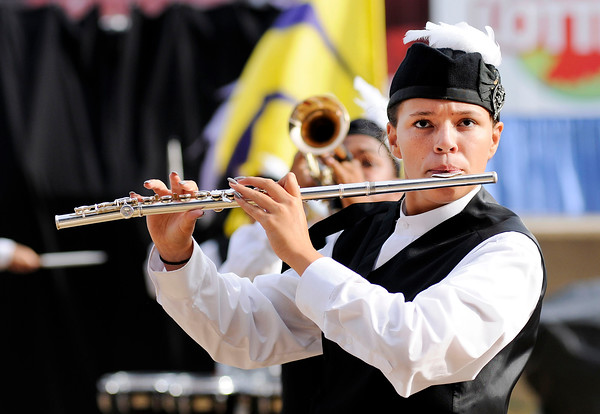 Don Knight    The Herald Bulletin<br /> A flutist performs with the Anderson Marching Highlanders during Band Day at the State Fair on Saturday.