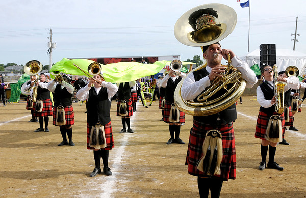 Don Knight |  The Herald Bulletin<br /> The Anderson Marching Highlanders perform during Band Day at the State Fair on Saturday.