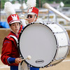 Don Knight |  The Herald Bulletin<br /> Cameron Vest plays the bass drum as the Panther Band performs during Band Day at the State Fair on Saturday.