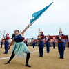 Don Knight    The Herald Bulletin<br /> Panther Band guard member Madison Sutherland points her flag toward the sky as the Panthers performed during Band Day at the State Fair on Saturday.