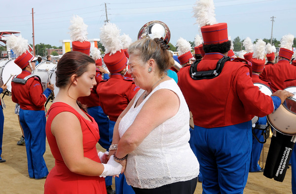 Don Knight |  The Herald Bulletin<br /> Elwood band director Paula Simmons takes time with each of her students including drum major Morghan Ziegler during Band Day at the State Fair on Saturday.