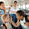 Don Knight |  The Herald Bulletin<br /> Abby Specht, right, helps Joelle Miller with her make up as the Lapel Marching Bulldogs prepare for their Band Day performance at the State Fair on Saturday.