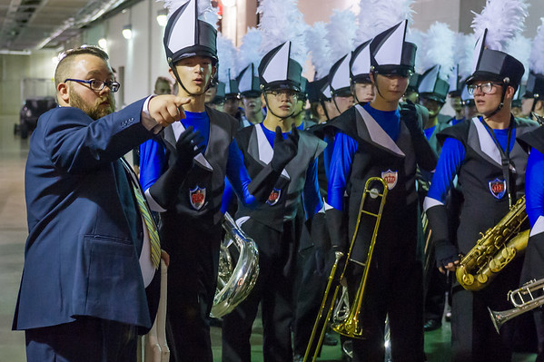 Lewis Cass Marching Kings band director Andrew Muth gives the band members last minute instructions in the tunnel before they go out and perform. Fran Ruchalski | Pharos-Tribune