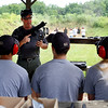 Holly Pelczynski - Bennington Banner Bennington Chief of Police, Paul Ducette, show campers how to use SIG MPX rifle.