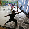 Billerica Memorial High School Winter Color Guard, practices at Hajjar Elementary School for upcoming competition in Dayton. Brandon Bouley, 15, center. (SUN Julia Malakie)