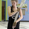 Kaitlyn Bowen, 15, with Billerica Memorial High School Winter Color Guard, practices at Hajjar Elementary School for upcoming competition in Dayton. (SUN Julia Malakie)