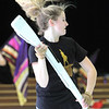 Ali Burton, 16, with Billerica Memorial High School Winter Color Guard, practices at Hajjar Elementary School for upcoming competition in Dayton. (SUN Julia Malakie)