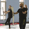 Billerica Memorial High School Winter Color Guard, practices at Hajjar Elementary School for upcoming competition in Dayton. Cassie Modoono, 13, left, and Ali Burton, 16, follow choreographer Ray Acevedo of Miami, who's a friend of the coaches and comes up several times a year to help coach the group. (SUN Julia Malakie)