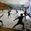 Billerica Memorial High School Winter Color Guard, practices at Hajjar Elementary School for upcoming competition in Dayton. Courtney Williams, 17, left, and Brandon Bouley, 15, center. (SUN Julia Malakie)