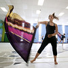 Chelsey Mathews, 15, with Billerica Memorial High School Winter Color Guard practices, at Hajjar Elementary School for upcoming competition in Dayton. (SUN Julia Malakie)
