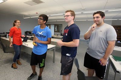 """Billerica High students competing for a InvenTeam Award get training on """"Design Thinking"""" from IBM employees. From left, IBM UX designer Erika Vargas of Townsend, Billerica High rising sophomore Karan Rana, 14, and seniors James Pope, 17, and Jacob Isaac, 17. (SUN/Julia Malakie)"""