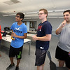 "Billerica High students competing for a InvenTeam Award get training on ""Design Thinking"" from IBM employees. From left, IBM UX designer Erika Vargas of Townsend, Billerica High rising sophomore Karan Rana, 14, and seniors James Pope, 17, and Jacob Isaac, 17. (SUN/Julia Malakie)"