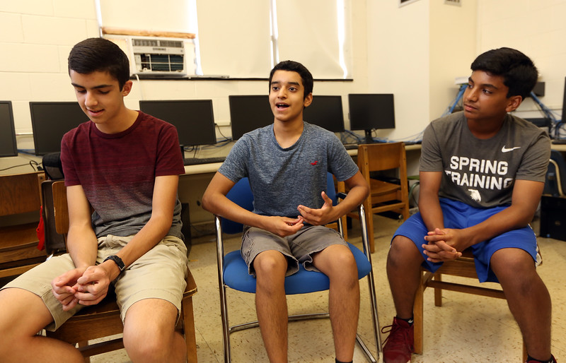 From left, Billerica High senior Cory Lafleur, 17, and sophomores Shashank Jarmale, 15, and Saketh Mynampati, 15, participated in STEM projects at MIT's Beaver Works Summer Institute. (SUN/Julia Malakie)