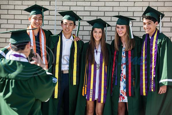 Bishop Thomas K. Gorman Cathedral School graduate Jacob Viray takes a photo of classmates Jain Carlo Petosa, Nasa Story, Valerie Macedo, Marla Danly and Alex Bonachea.