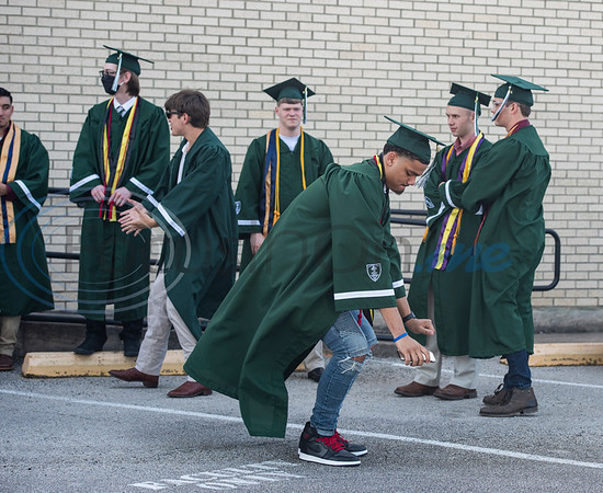 Bishop Thomas K. Gorman Cathedral School graduate Miles Minnick dances before the start of the ceremony.