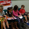 Holly Pelczynski - Bennington Banner 2nd graders read their new books provided by aim during the book fair at Monument Elementary school in Bennington on Wednesday morning. From let to right. Alex Brazeau, Kavanni Bynum, Madalynn Bebon, and Sam Berard.
