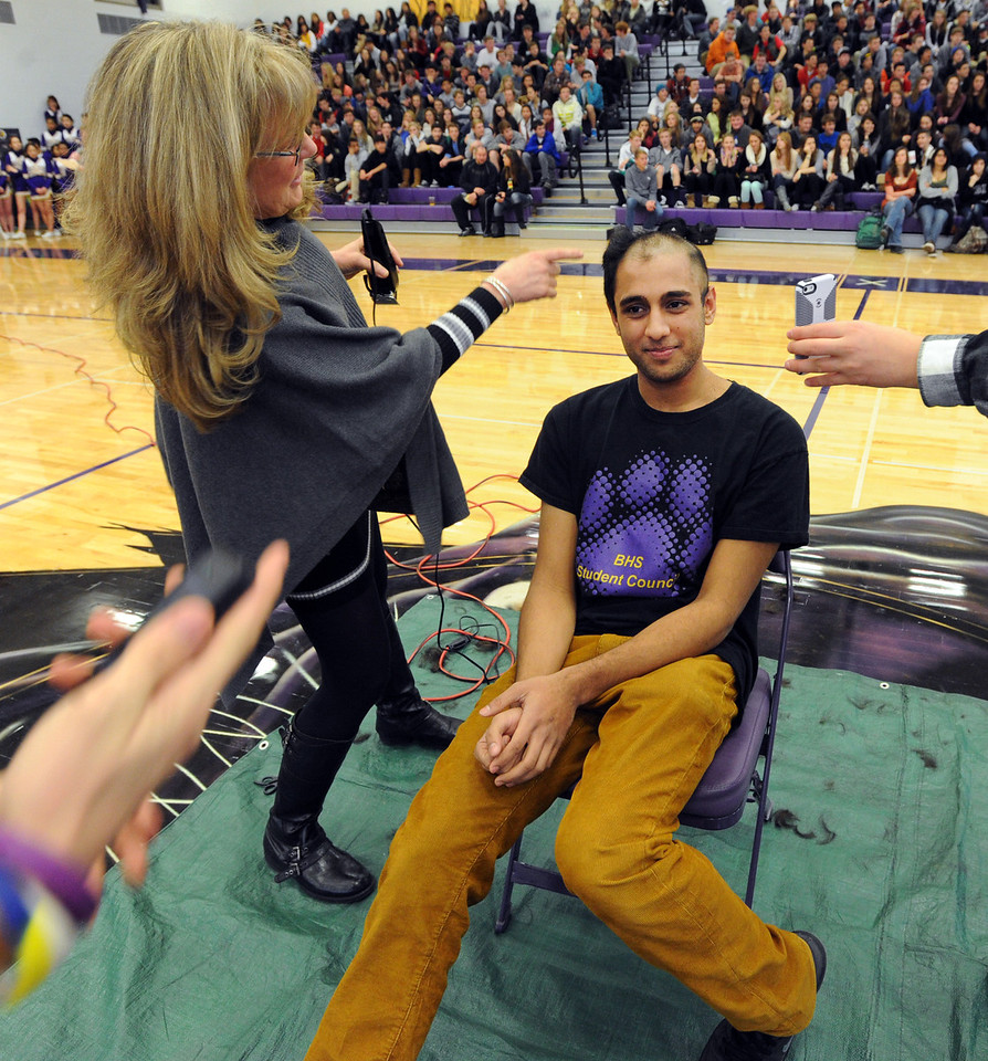"Boulder High student, Neil Sandhu, is having his head shaved for charity by Tamara Butler during the rally. <br /> Boulder High School held their Winter Rally on Thursday, with dance performances, team introductions, and head shaving for charity.<br /> For a video and more photos of the Rally, go to  <a href=""http://www.dailycamera.com"">http://www.dailycamera.com</a>.<br /> <br /> Cliff Grassmick  / January 10, 2013"