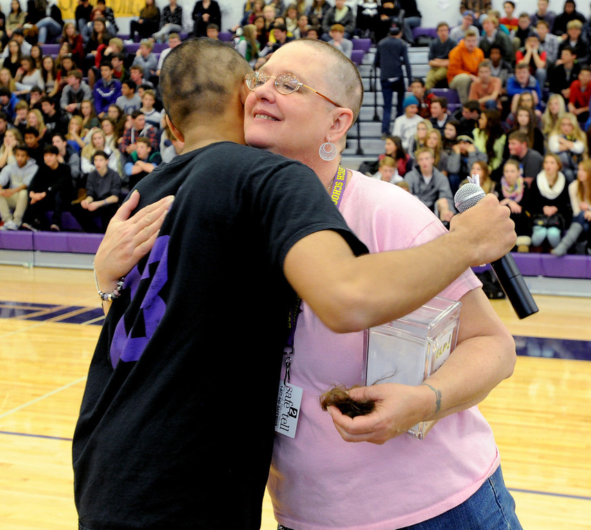 "Security staff member, Robbie Jerger, is hugged by student, Neil Sandhu, after both hand their heads shaved for charity during the rally.<br /> Boulder High School held their Winter Rally on Thursday, with dance performances, team introductions, and head shaving for charity.<br /> For a video and more photos of the Rally, go to  <a href=""http://www.dailycamera.com"">http://www.dailycamera.com</a>.<br /> Cliff Grassmick  / January 10, 2013"