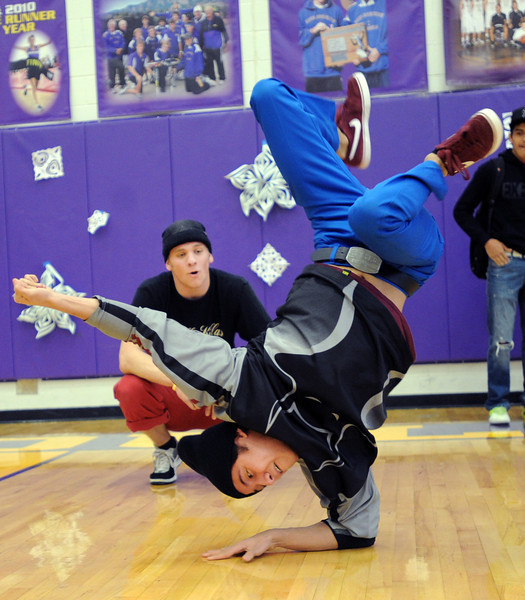 "Julio Lemos, a member of the Side by Side dancers, performs at the rally.<br /> Boulder High School held their Winter Rally on Thursday, with dance performances, team introductions, and head shaving for charity.<br /> For a video and more photos of the Rally, go to  <a href=""http://www.dailycamera.com"">http://www.dailycamera.com</a>.<br /> Cliff Grassmick  / January 10, 2013"