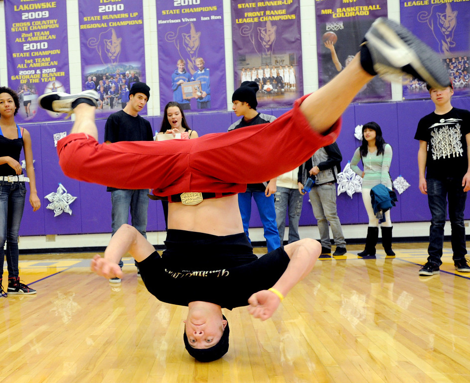 "Alex Milewski, a member of the Side by Side dancers, performs at the rally.<br /> Boulder High School held their Winter Rally on Thursday, with dance performances, team introductions, and head shaving for charity.<br /> For a video and more photos of the Rally, go to  <a href=""http://www.dailycamera.com"">http://www.dailycamera.com</a>.<br /> Cliff Grassmick  / January 10, 2013"