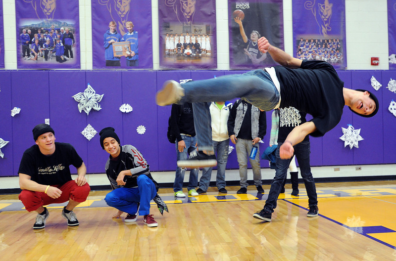 "Larkin Poyton, a member of the Side by Side dancers, performs at the rally.Dancers, Alex Milewski, left, and Julio Lemos, watch on the left.<br /> Boulder High School held their Winter Rally on Thursday, with dance performances, team introductions, and head shaving for charity.<br /> For a video and more photos of the Rally, go to  <a href=""http://www.dailycamera.com"">http://www.dailycamera.com</a>.<br /> Cliff Grassmick  / January 10, 2013"