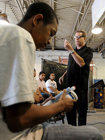 """Scott Rex of Rex Marketing, shows auto students his dent repair products at the auto classes at CTEC. Patrick  Young is on the left getting a closer look.<br /> For more photos and a video from CTEC, go to  <a href=""""http://www.dailycamera.com"""">http://www.dailycamera.com</a><br /> Cliff Grassmick / May 3, 2012"""