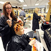 "Grace Garza, left, styles the hair of Lorraine Baynton at  the cosmetology school at Boulder Valley Schools Career and Technical school in Boulder.<br /> For more photos and a video from CTEC, go to  <a href=""http://www.dailycamera.com"">http://www.dailycamera.com</a><br /> Cliff Grassmick / May 3, 2012"
