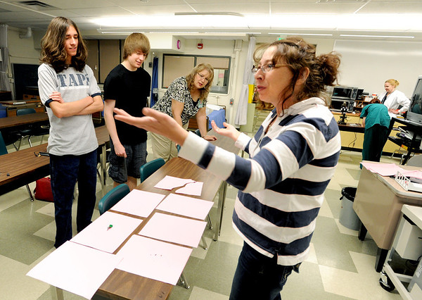 "Zoeann Corn, right, a forensics instructor at Boulder Valley Schools career and technical school, talks about finding evidence. Dylan Frost, left, and Austin Krahl are students in the class.<br /> For more photos and a video of career and technical classes at BVSD, go to  <a href=""http://www.dailycamera.com"">http://www.dailycamera.com</a>.<br />  Cliff Grassmick / May 2, 2012"