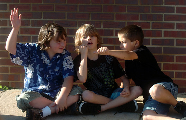 Fourth-graders, left to right, Tony Sanchez, Cameron Heintz and Tyler Victory goof around while taking part in a game designed to learn students' names at the first day of school at Crestview Elementary School on Thursday.<br /> Photo by Marty Caivano / The Camera / August 20, 2009