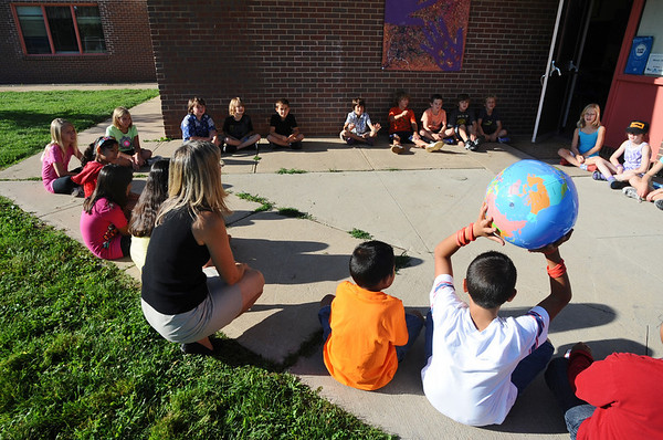 Cindy Monnet's fourth-grade class plays a game to remember each other's names at the first day of school at Crestview Elementary School on Thursday.<br /> Photo by Marty Caivano / The Camera / August 20, 2009
