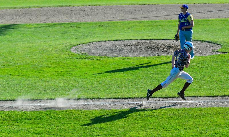 KRISTOPHER RADDER — BRATTLEBORO REFORMER<br /> Brattleboro's Evan Finnell runs home to score as Bennington's Dylan Babson watches the ball during an American Legion baseball game at Tenney Field, in Brattleboro, on Wednesday, June 12, 2019.