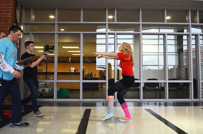 """Kassidy Mason and videographer  Tyler DiPietro work on first take of """"Brave"""" video at Souderton Area High School.   Wednesday,  March 12, 2014.  Photo by Geoff Patton"""