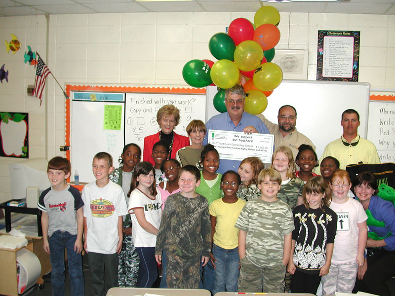Todd Grant Elementary students in Phyllis Smith's class gathered to celebrate their teacher winning a $1,280 grant. With the students are Coastal Electric Board Member Barbara Davis, Asst. Prinicipal Carolyn Smith, Coastal Electric CEO Whit Hollowell, and Coastal Electric employees Robert Moore, Billy Kirk and Anne Cordeiro.