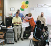 Barbara Davis hugs Cindy Jarriel, who won a $650 grant to create a traveling book mobile at McIntosh County Middle School.