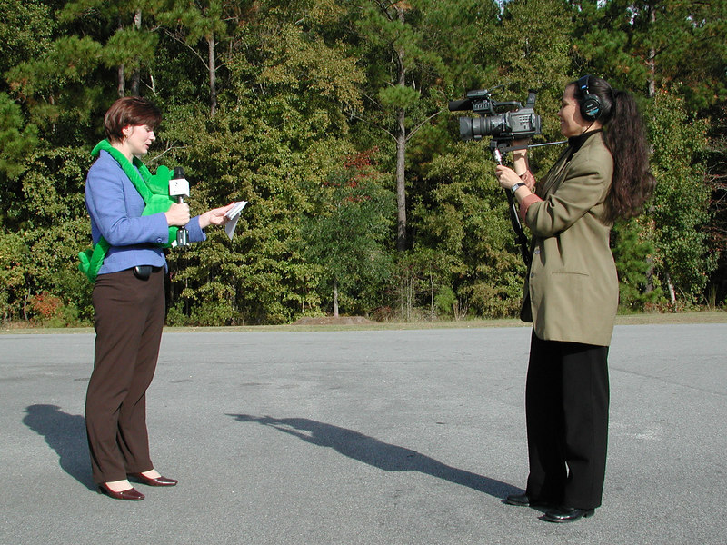 What is my line. Coastal Electric Cooperative's Director of Communications Anne Cordeiro became a news reporter for the day. Filming is Patricia Buskirk.